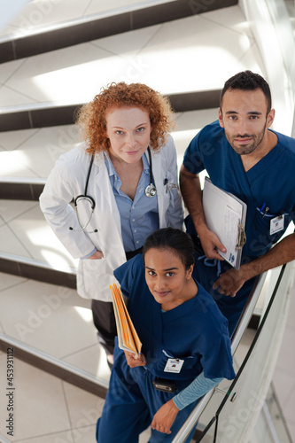 Doctor and nurses on hospital steps