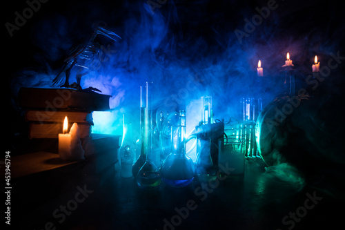 Halloween still-life background with different elements on dark toned foggy background Fototapet