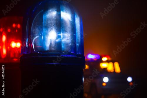 Stampa su Tela Police car blue and red round vintage siren in dark