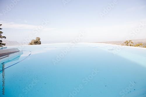 Wallpaper Mural Infinity pool overlooking hillside