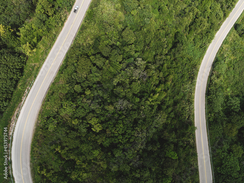 Fotografie, Obraz Aerial view forest nature with car on the road on the mountain green tree, Top v