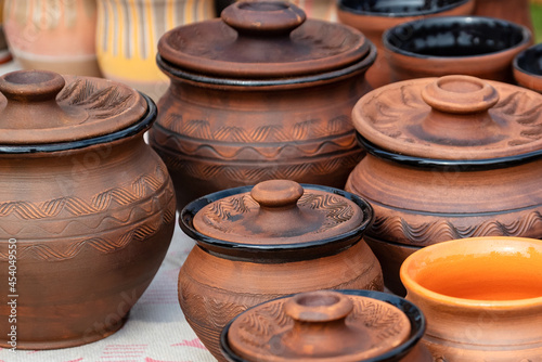 Fotografie, Tablou Set of handmade clay pots on the diy fair counter