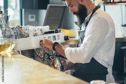 Fotografering Barista Making a Cappuccino in a Coffee Chop
