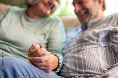 Canvastavla elderly life, two people holding hands, details of elderly adult hands, concept