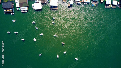 Foto Drone view of boat houses, river and boats at summertime.