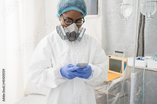 Stampa su Tela Doctor using smartphone in the hospital while curing and treating sick patients