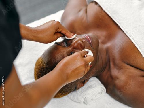 Mature woman receiving beauty treatment Poster Mural XXL