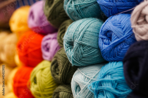 Many colorful yarn for handmade knitting in a needlework shop. Fototapet