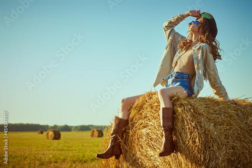 Canvastavla hippie girl on a haystack