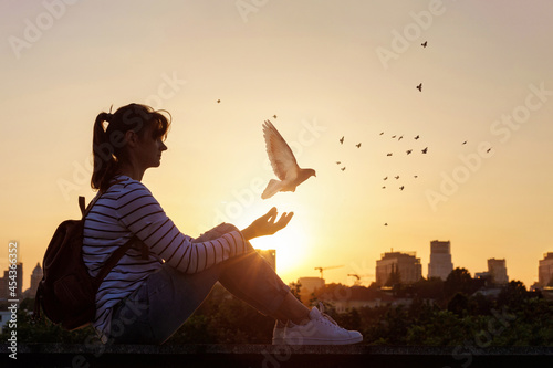 Woman releases a dove and prays . Fototapet