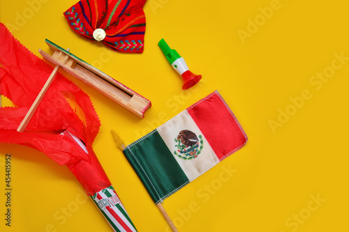 Fotografiet Decoration of independence day with Mexican flags, whistle of colors, rattle, folklore ribbon and cornet decorated