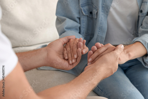 Fotografering Religious people holding hands and praying together indoors, closeup