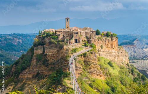 Obraz na plátně The famous Civita di Bagnoregio hit by the sun on a stormy day