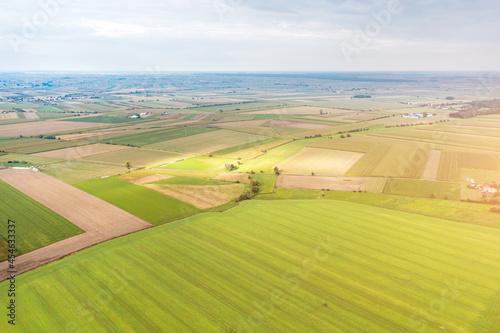 Obraz na plátně picturesque landscape on green fields lit by the sun endless spaces, rural lands