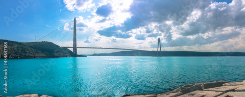 Obraz na plátně Panoramic view of Yavuz Sultan Selim Bridge in Istanbul and cloudy sky on the background