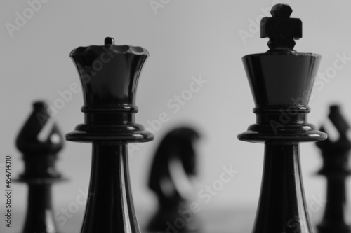 Canvas King and queen chess piece with bishops and knights in background