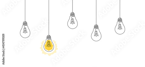 Foto One continuous line drawing of hanging light bulbs with one shining
