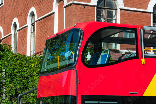 Slika na platnu The second floor of a double-decker tourist bus, the windows of the bus during t