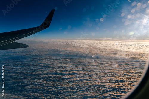 Fototapeta Sunlight raking over the top of clouds