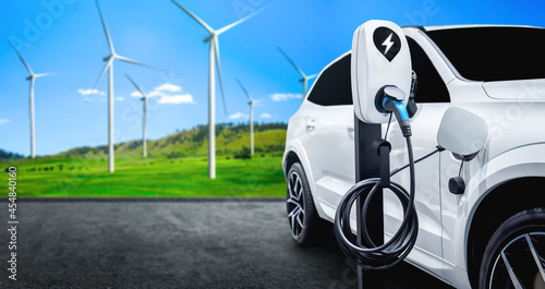 EV charging station for electric car in concept of green sustainable energy produced from renewable resources to supply to charger station in order to reduce CO2 emission .