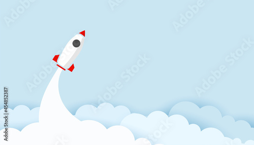 Canvas flyer space rocket over the clouds in paper cut style
