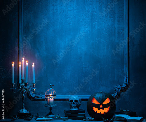 Fotografering Scary laughing pumpkin and old skull on ancient gothic fireplace