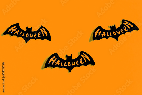 Fototapeta Ghosts and bats on a yellow and blue background. Halloween party