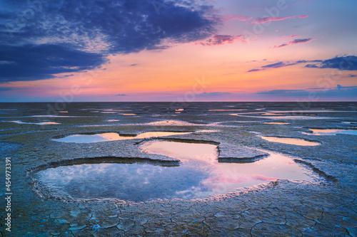 Stampa su Tela Low tide in mudfltas and sunset at the waddensea