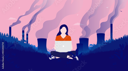 Fotografie, Obraz Working for a better climate - Woman sitting with laptop in polluted landscape using technology to fight climate change