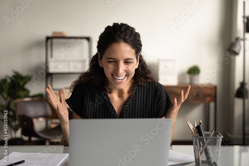 Fotografie, Tablou Happy excited businesswoman surprised and overjoyed with good news, celebrating