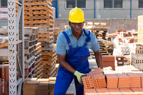 Obraz na plátně African american employee working in an open air building materials warehouse la