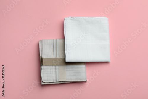 Fotografia Stylish handkerchiefs on pink background, flat lay