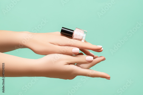 Slika na platnu Female hands with pink nail design