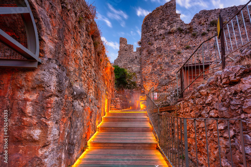 Fototapeta Beautiful castle on the hill in Alanya city at sunset. Turkey