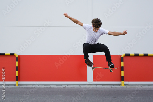 Obraz na plátně young skater does tricks outdoor