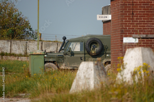Canvas Print a british army Land Rover Defender light utility military vehicle parked in a co