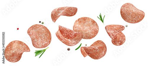 Fotografering Sliced salami sausage isolated on white background