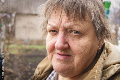 Obraz na plátně Portrait of Elderly Caucasian woman looking at camera. Close-up