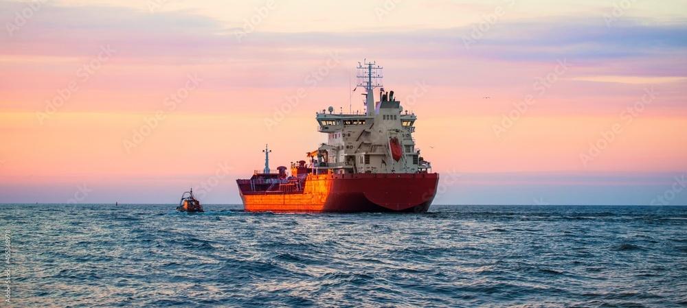 Leinwandbild Motiv - Alex Stemmers : Large cargo ship sailing at sunset. Baltic sea. Panoramic view. Freight transportation, logistics, global communications, economy, business, industry