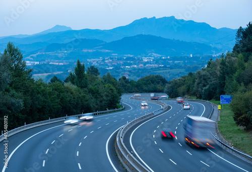 Billede på lærred Cars at dusk on the A8 highway, city of Donostia-San Sebastian, Euskadi
