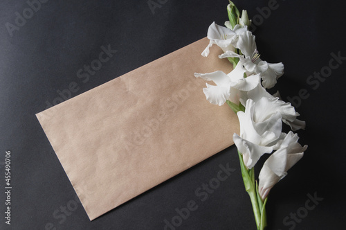 Wallpaper Mural bouquet of white gladioli on black background with envelope