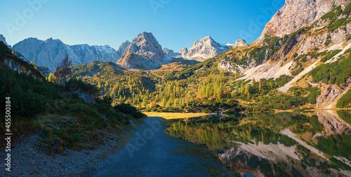 walkway along alpine lake Seebensee, with Mieminger Alps, hiking area Ehrwald