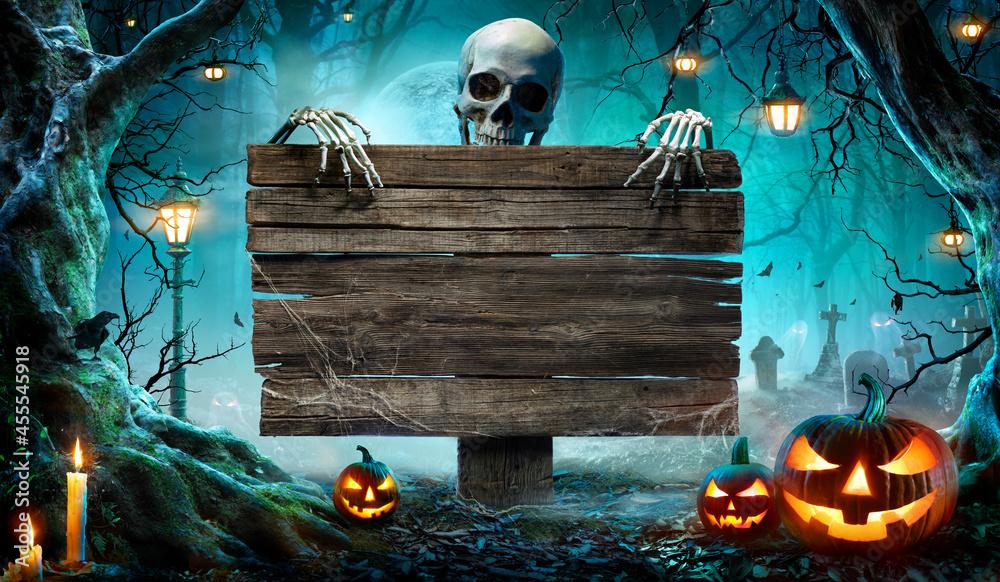 Leinwandbild Motiv - Romolo Tavani : Halloween Party Card - Pumpkins And Skeleton In Graveyard At Night With Wooden Board