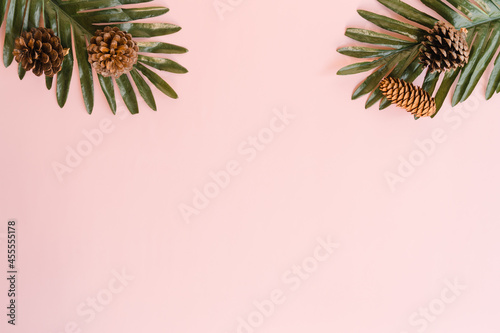 Creative flat lay photo of travel vacation spring or summer tropical fashion. Top view beach accessories on pastel pink color background with blank space for text. Top view copy space photography.