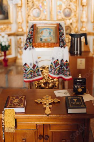 Fotografija Prayer books with cross and scissors for the baptismal ceremony
