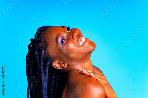 Wallpaper Mural african american woman with gorgeus bright color make up feels proud and self co