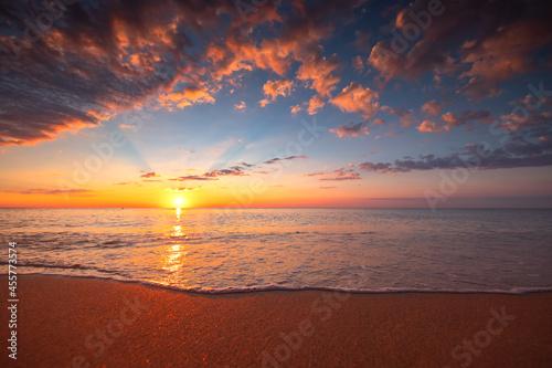 Fototapeta Beach sunrise over the tropical sea