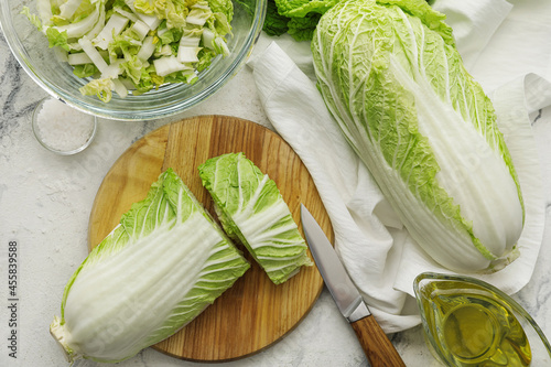 Canvas Board with fresh chinese cabbage on light background