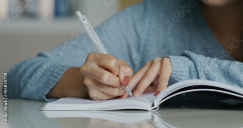 Housewife write on the notebook Fototapet