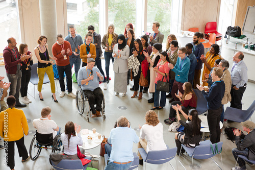 Canvas Speaker in wheelchair talking to conference audience